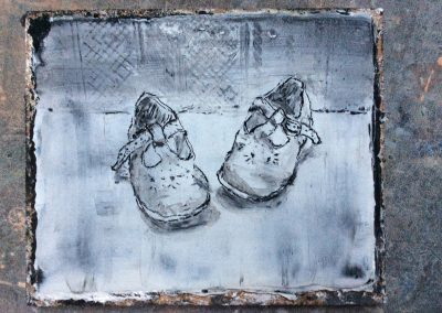 A pair of toddlers shoes in sgraffito on lime plaster
