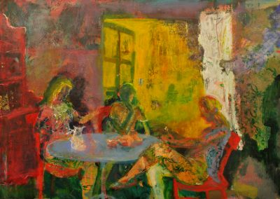 Three women sit at a table by an open French window