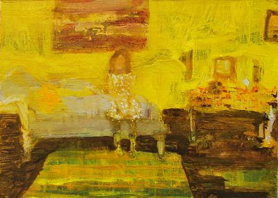 A girl sits in a yellow room with an abstract painting behind her.