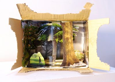 A diorama of a park with a runner