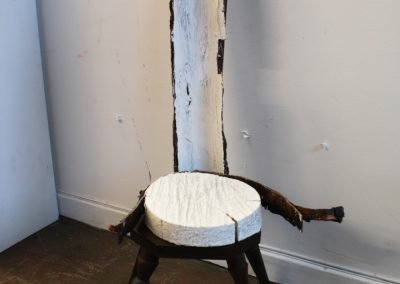 Two bark sculptures on a chair